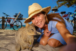 Lady taking selfie with Quokka (Setonix brachyurus) on Rottnest Island.